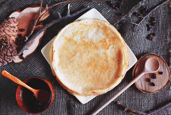 Pancakes, wooden spoons and natural, decorations on burlap background - image gratuit #136449