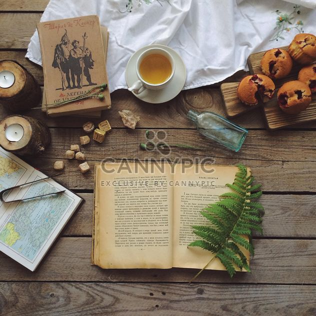 Open book, cup of tea and cupcakes - Free image #136589