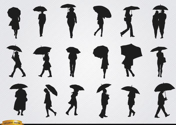 People walking with umbrella silhouettes set - vector #182359 gratis