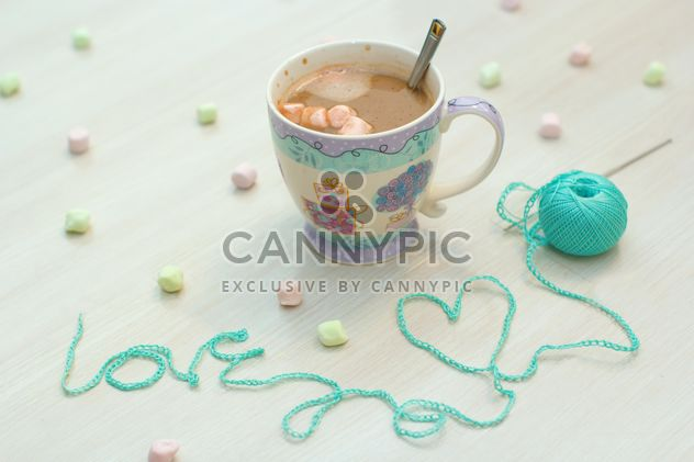 Cup of hot cocoa on white background - Free image #182569