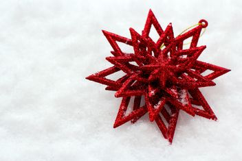 Red Christmas toy in snow - Free image #182599
