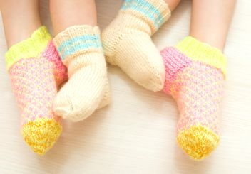 Children in warm socks, two sisters - image #182639 gratis