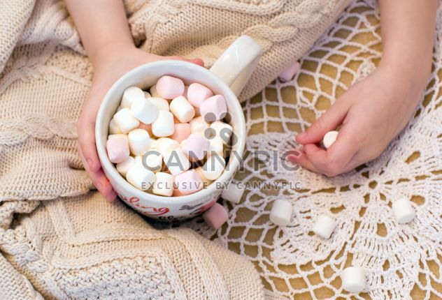 Cup of marshmallows in child's hand - Free image #182659