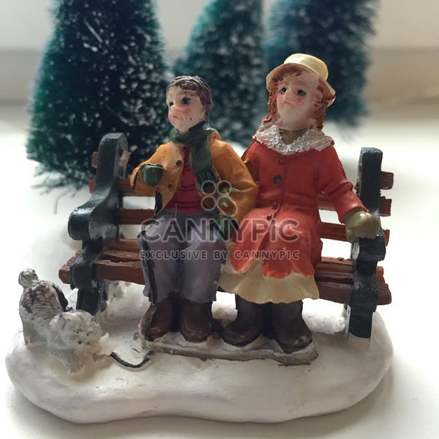 Closeup of ceramic figurines on white background - Free image #182949