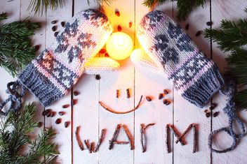 Wool mittens and candle - image #183729 gratis