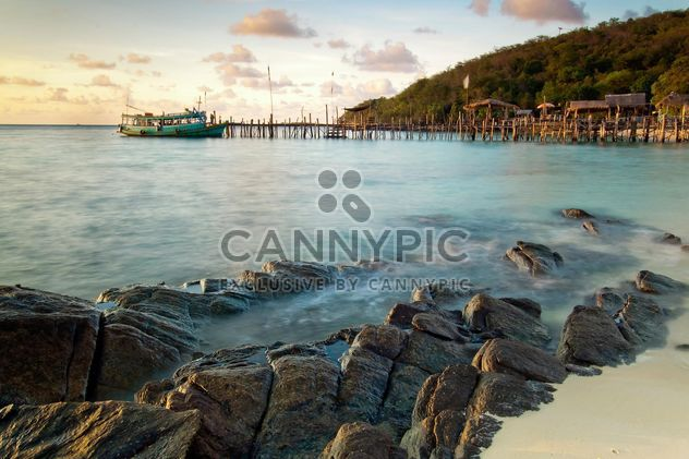 Landscape with stones in sea and boat on background - Free image #183839