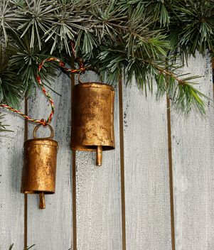 Christmas tree decoration,metal bells in the pine tree - image #183909 gratis