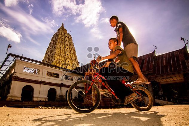 Two boys on a bicycle in Thai city - Free image #184189