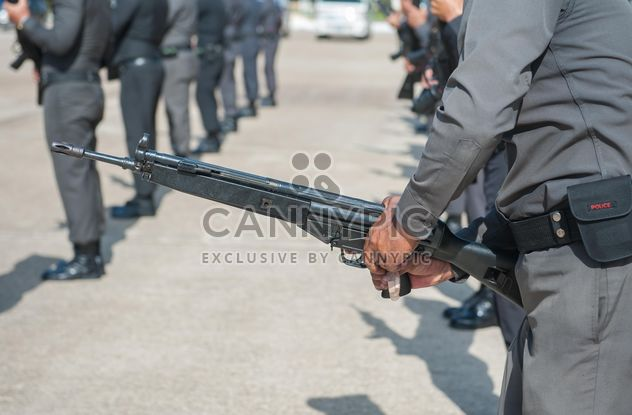 Close-up of policeman hands with gun - Free image #186299