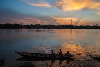 Boat in river at sunset - Free image #186519