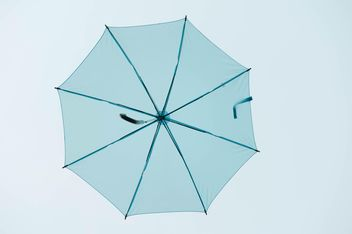 Blue umbrella hanging - image #186539 gratis