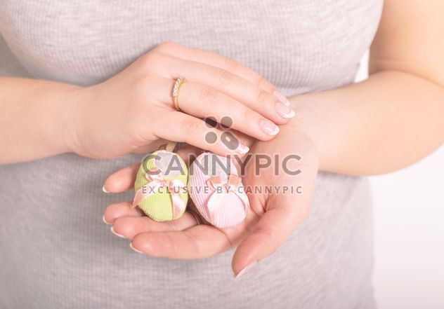 Baby's bootees in hands of woman - Free image #186719