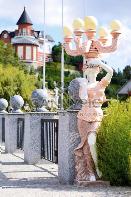 Statue of woman on bridge - Free image #186739