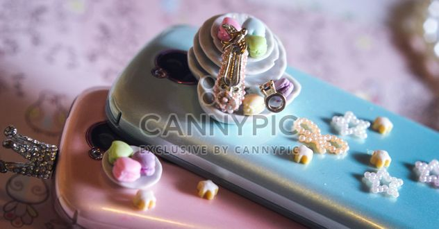 two smartphones pink and blue with stars and little plate - Free image #187259
