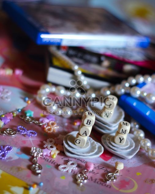 wooden letters and beads on the background of books - Free image #187269
