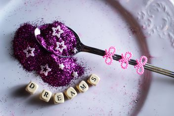 purple shiny sequins in a spoon - image #187309 gratis