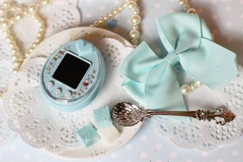 Tamagotchi and decorations on table - бесплатный image #187659