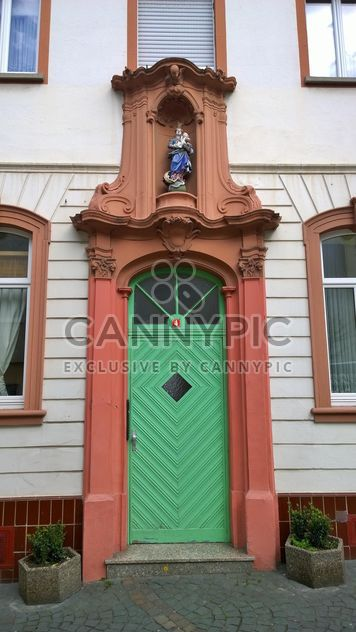 Facade of house with green door - Free image #187869