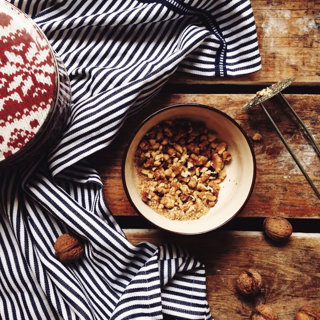 Crushed nuts in bowl and dishcloth - Free image #198429