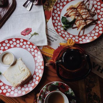 Pancakes and tea for breakfast, view from above - бесплатный image #198489