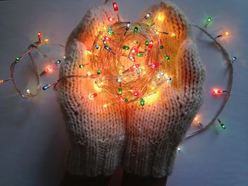 Soft warm knitted mittens hold garland - image #198779 gratis
