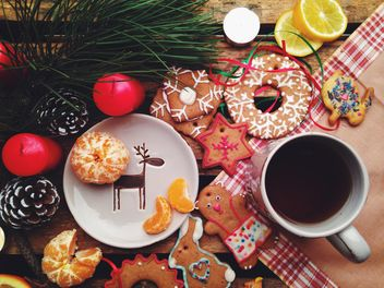composition with Christmas cookies candles and tangerines - image #198849 gratis