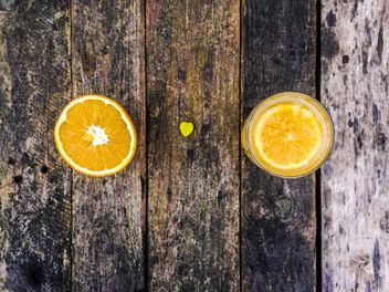 Orange juice on wooden table - image #198939 gratis