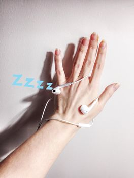 Female hand with earphones on white background - бесплатный image #198999