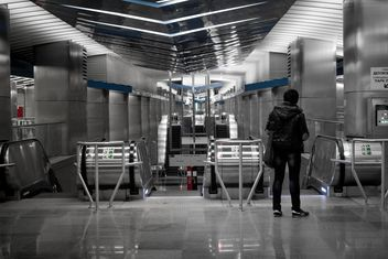 Person near turnstiles at subway station - бесплатный image #200739