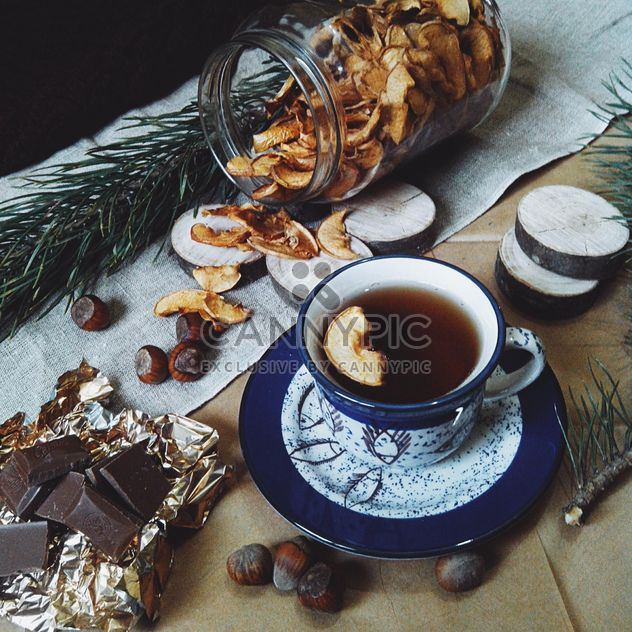 Cup of tea, dried apples and chocolate - Free image #272249