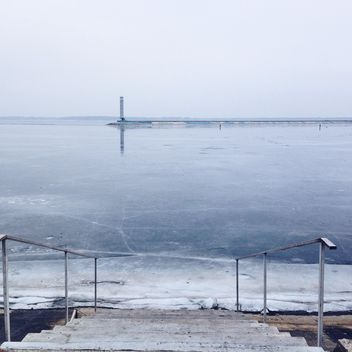 Frozen pond and lighthouse in the distance - image gratuit #273879