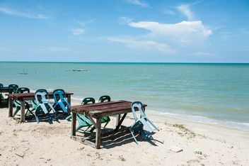 Tables and chair on beach - Free image #275089