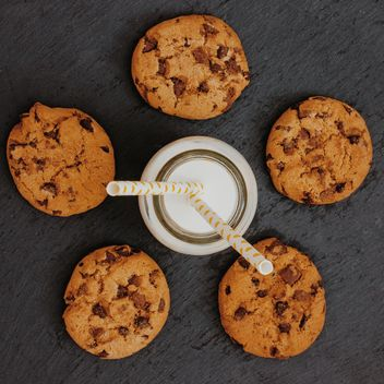 Glass of milk with chocolate chip cookies - Free image #303219