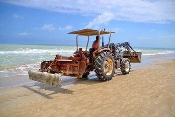 a tractor traveling down the the beach - Free image #303339