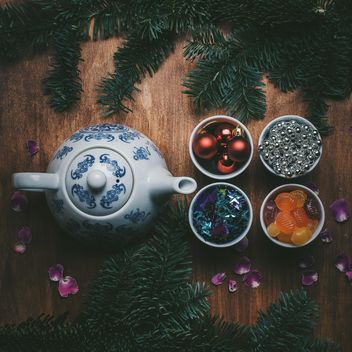 Teapot and Christmas decorations on wooden background - Kostenloses image #303949