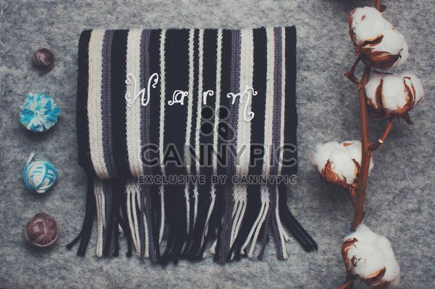 Warm striped scarf, branch of cotton and yarn - Free image #305389