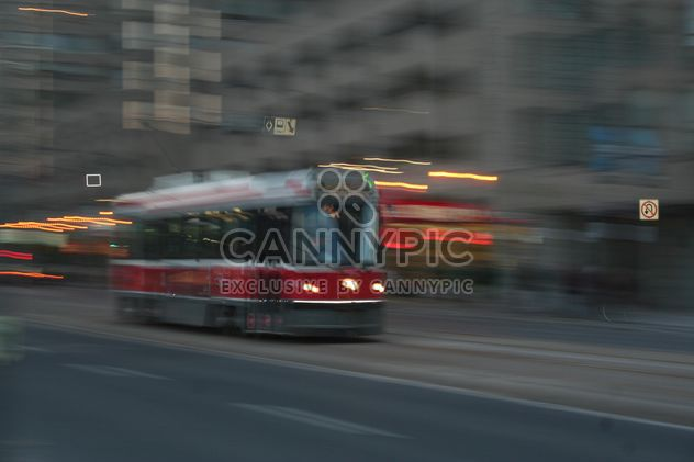 Red Tram in motion in Toronto - бесплатный image #305689