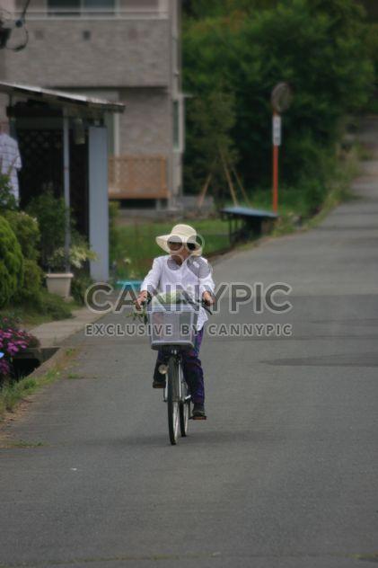 Old Japanese Woman enjoying riding her bicycle - Free image #305739