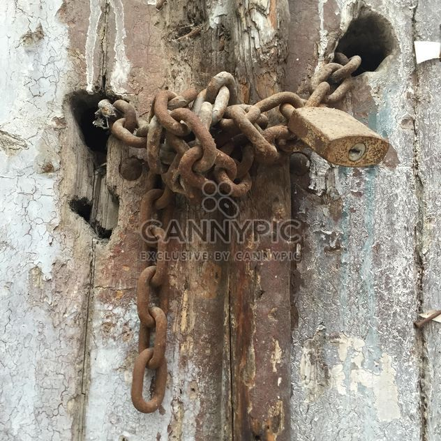 rusty lock on an old wooden door - Free image #305769