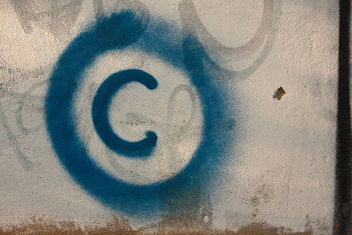 Large copyright graffiti sign on cream colored wall - image #313779 gratis