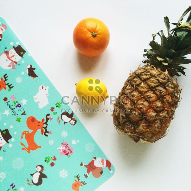 fruits and wrapper for gift on a white background - Free image #329259