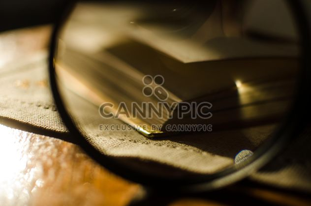 Autumn yellow leaves through a magnifying glass with incense sticks and book - Free image #330409