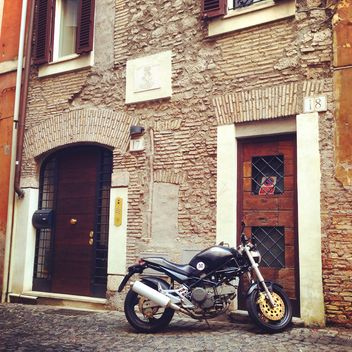 Ducati motorcycle near house - image #331109 gratis