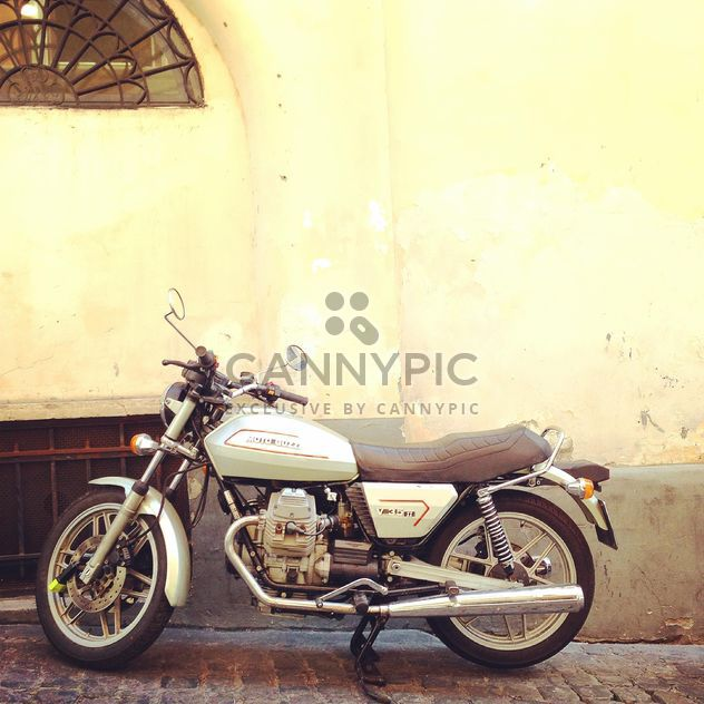 Moto Guzzi near building - бесплатный image #331249
