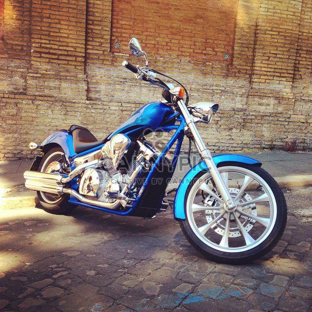 Motorcycle near brick building - Free image #331429