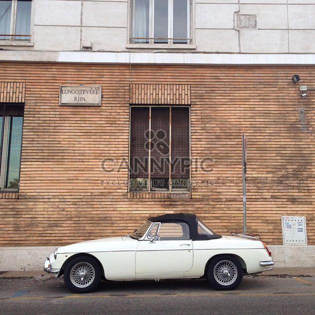 Retro white car near house - Free image #331539