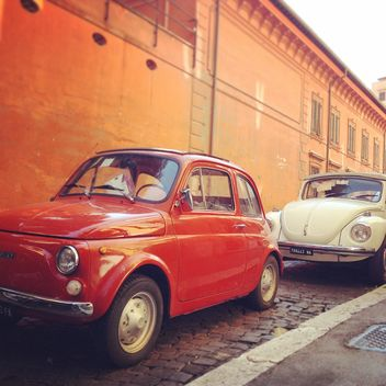 Old small cars in street - image #331879 gratis