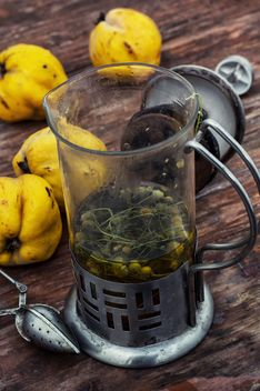 Still life of metal teapot and yellow pears - image #332779 gratis