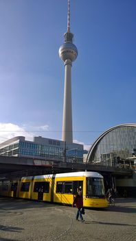 Yellow tram at the Alexanderplatz - image #335269 gratis