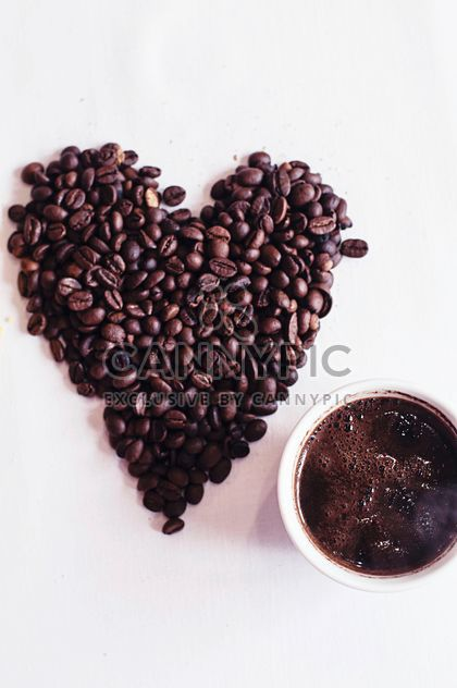Coffee beans and cup of coffee - Free image #337889